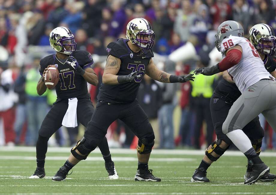Can the Dawgs avoid the injury bug? In addition to Kasen Williams, a handful of players — like offensive lineman Dexter Charles (above, center) — will miss all or parts of spring practice due to injury. Keeping the O-line healthy in particular will be a focal point of the Huskies training staff. After all five starters missed time in 2012 with a plethora of injuries, a healthy unit in 2013 brought cohesion to the Washington offense and played a big part in the team's success. Some injuries can't be avoided, particularly when players are still learning new systems, but how the Huskies emerge from the five weeks of practice this spring could go a long way to determining the team's fortunes in the fall. Photo: Stephen Brashear, Getty Images