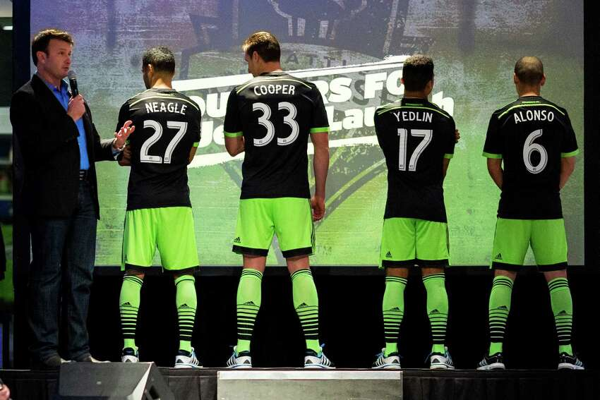 Sounders FC players show off the new black-and-green third kit uniforms for the 2014 season Monday, March 3, 2014, at CenturyLink Field in Seattle. The season home opener against Sporting KC is Saturday at noon.