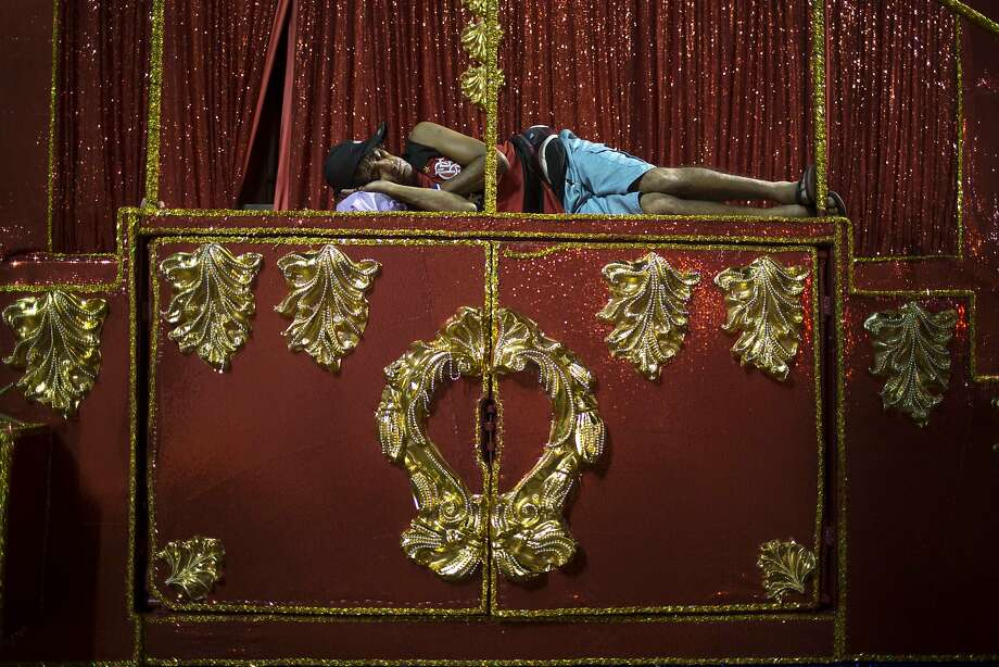 A member of the Uniao da Ilha do Governador samba school sleeps on a float outside the Sambadrome before carnival celebrations in Rio de Janeiro, Brazil, Monday, March 3, 2014. (AP Photo/Felipe Dana) Photo: Felipe Dana, Associated Press
