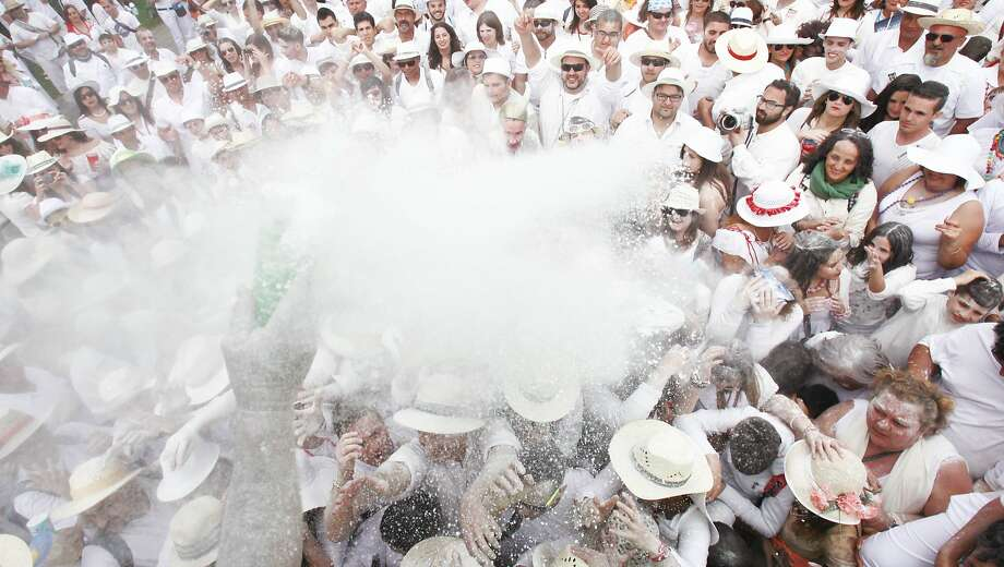 "People throw talcum powder as they take part in the carnival of ""Los Indianos"" (the Indians) in Santa Cruz de la Palma, on the Spanish Canary island of Las Palma on March 3, 2014.  TOPSHOTS/AFP PHOTO / DESIREE MARTINDESIREE MARTIN/AFP/Getty Images Photo: Desiree Martin, AFP/Getty Images"