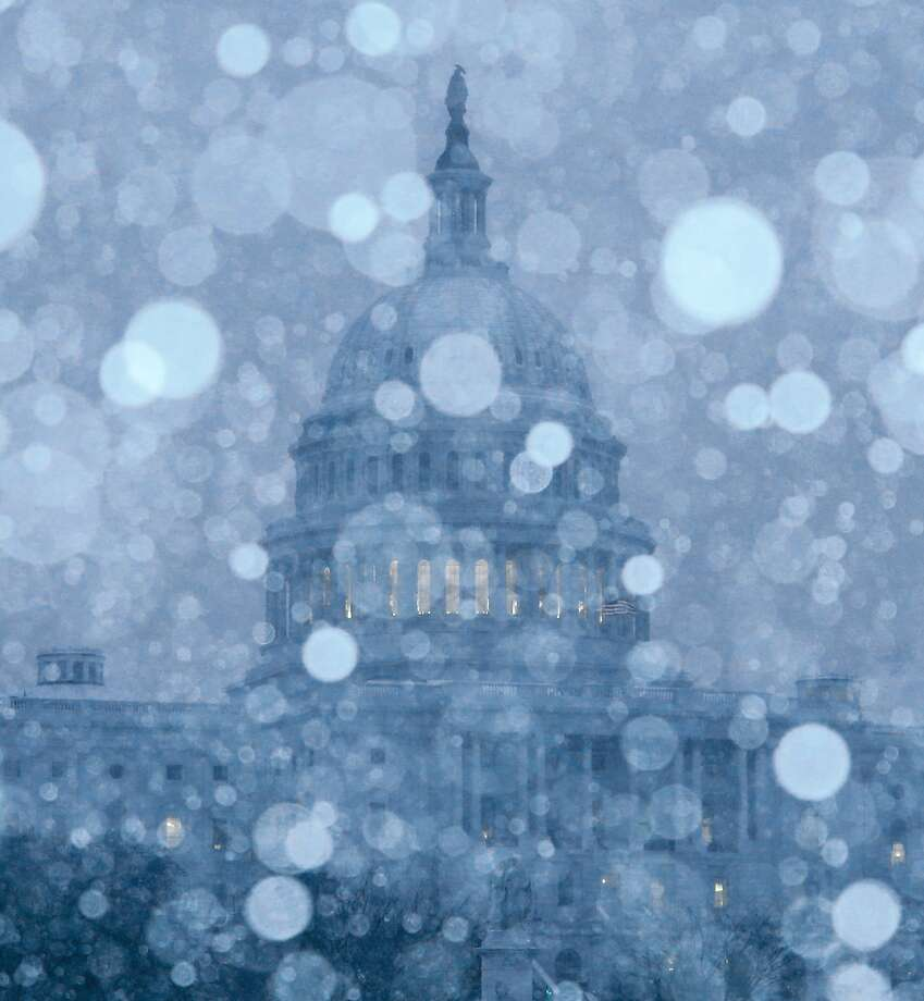 WASHINGTON, DC - MARCH 03:  Snow falls in front of the U.S. Capitol on March 3, 2014 in Washington, DC. The Federal Government is closed due to major snow storm that is expected to dump up to a foot of snow in the Washington area.  (Photo by Mark Wilson/Getty Images) Photo: Mark Wilson, Getty Images