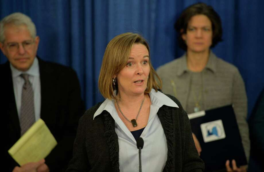 Kate Breslin, CEO of the Schuyler Center for Analysis & Advocacy is joined by members of Health Care for All New York (HCFANY) during a press conference Monday, March 3, 2014, at the Legislative Office Building in Albany, N.Y.  The allied groups gathered to discuss their campaign to ensure that the Assembly and Senate's bills to be released this week include a package of proposals that would improve health insurance affordability and coverage options available to consumers.  (Skip Dickstein / Times Union) Photo: SKIP DICKSTEIN / 00025969A