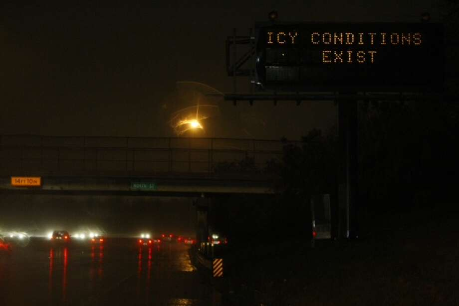 Emergency officials warn of icy conditions Tuesday morning along some roads and highways. (Cody Duty/Houston Chronicle)