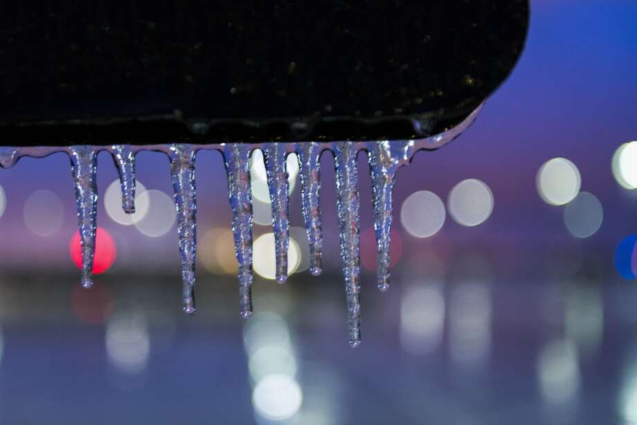 Icicles form on a sign on the roof of a parking garage at George Bush Intercontinental Airport on Tuesday, March 4, 2014, in Houston. Winter weather forced cancellation of flights at the airport and dangerous driving conditions for the morning commute. ( Smiley N. Pool / Houston Chronicle ) Photo: Smiley N. Pool, Houston Chronicle