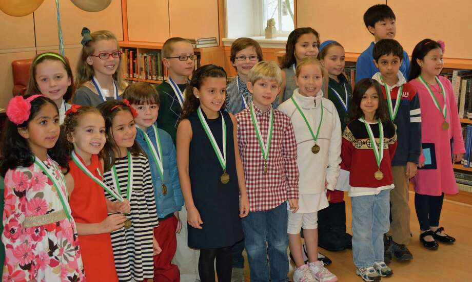 Twenty-two children were named 2013 Grimes Scholars in January at the New Canaan Library. The Grimes Scholar program is a year-long reading program conducted by the Children's Room that challenges avid readers to read books from the Karen Grimes Collection of Classic Children's Books. Photo: Contributed Photo, Contributed / New Canaan News Contributed