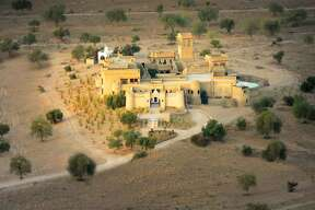 Most Extraordinary Places to Stay   1.  Mihir Gahr   (Rajasthan, India)     It took 150 masons, artisans and craftsmen two years to build what the owners describe as 'a dream realized.' — Lonely Planet