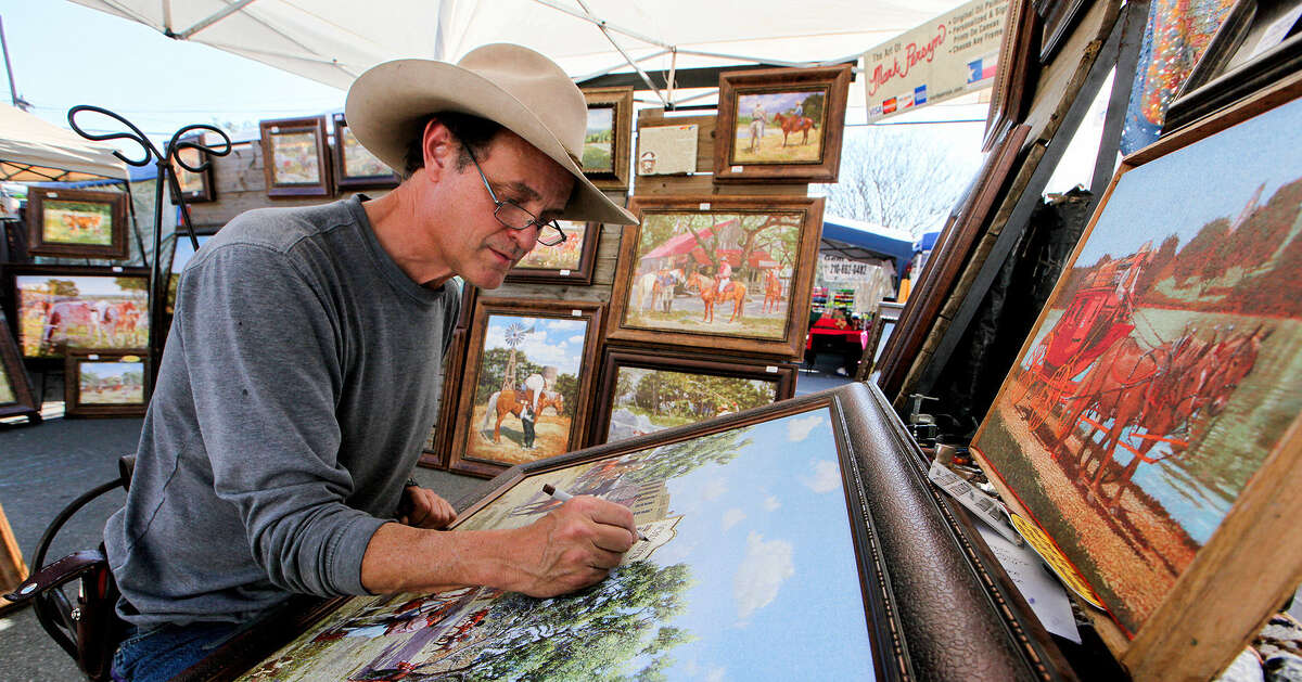 Mark Persyn personalizes one of his prints for a customer Saturday at The Marketplace at Old Town Helotes.