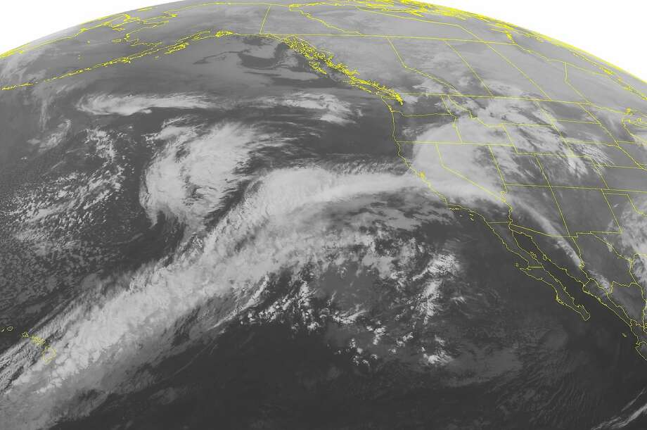 This NOAA satellite image taken Tuesday morning shows extensive cloudiness over much of northern and central California with persistent rain showers. Photo: Noaa, Associated Press