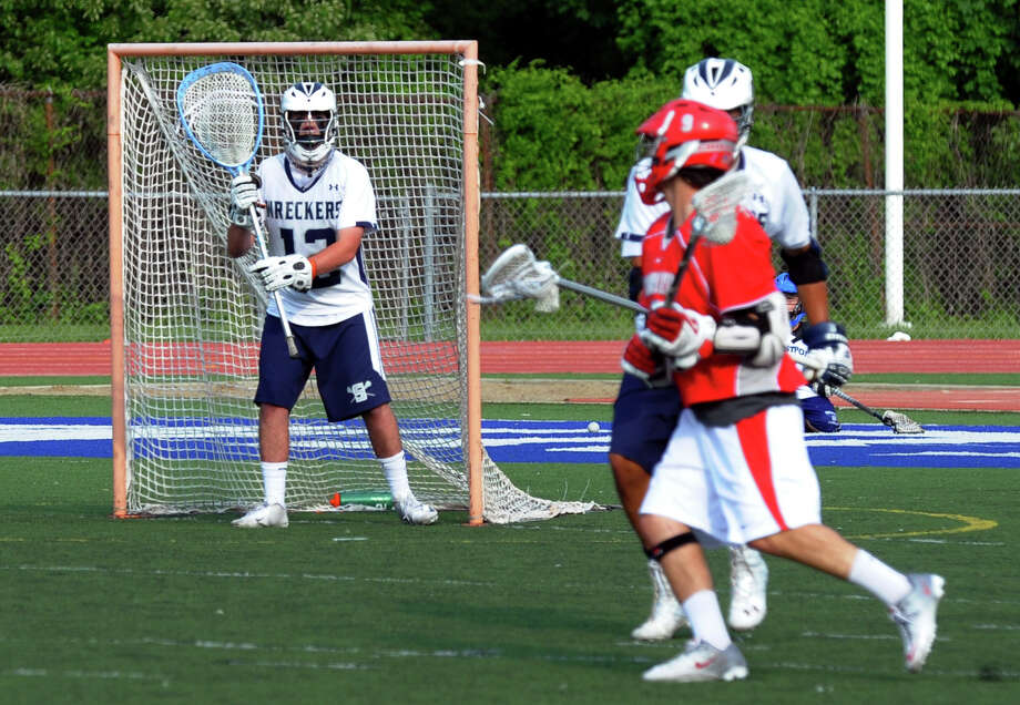 Staples goalie Cole Gendels watches a Conard player advance, during CIAC Division L state tournament lacrosse action in Westport, Conn. on Wednesday May 29, 2013. Photo: Christian Abraham / Connecticut Post