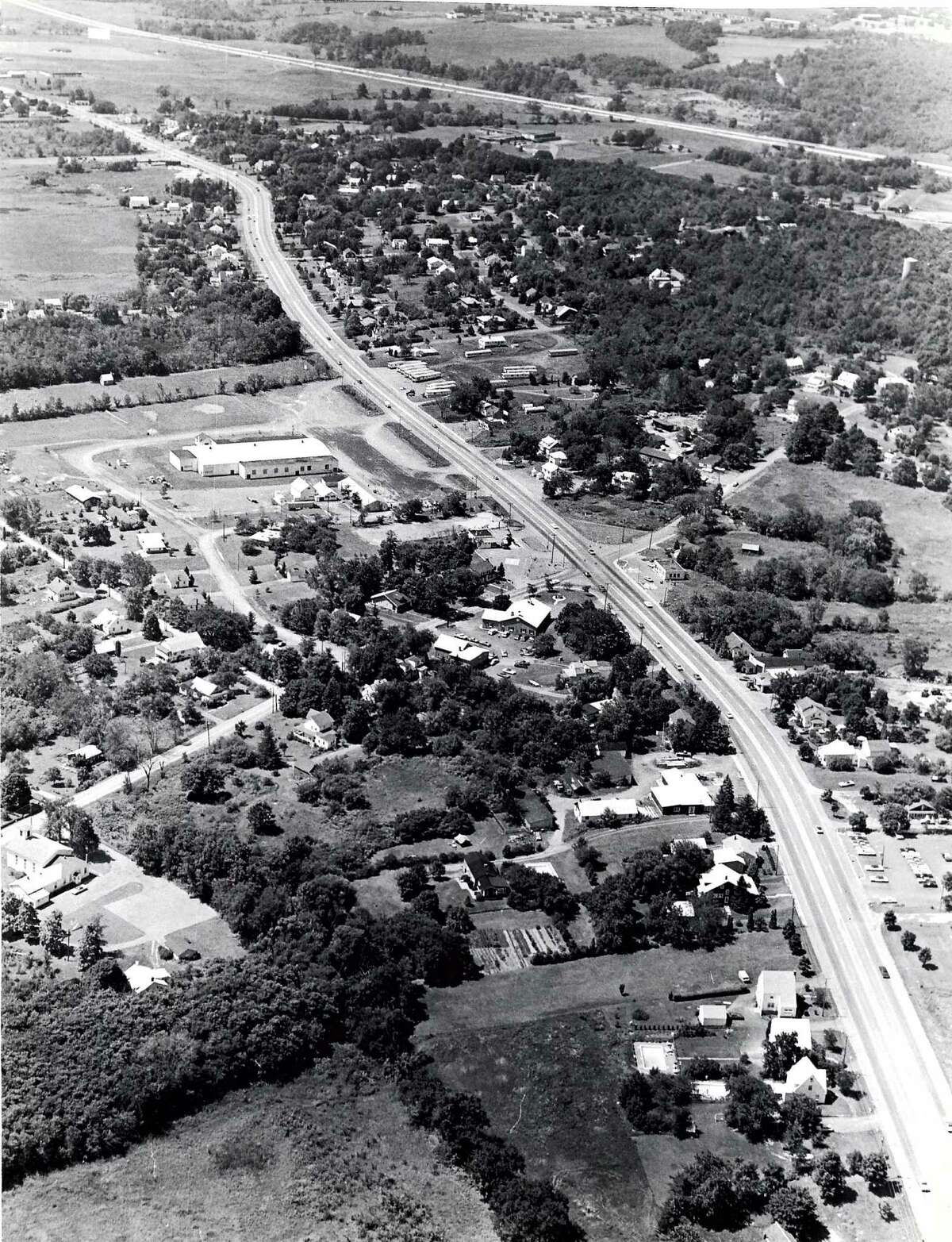 Colonie and the suburbs around Albany developed as people were drawn away from the cities seeking a rural way of life and the American Dream. Look back at historic photos from the Capital Region.Historic Colonie: Aerial view of Route 9.