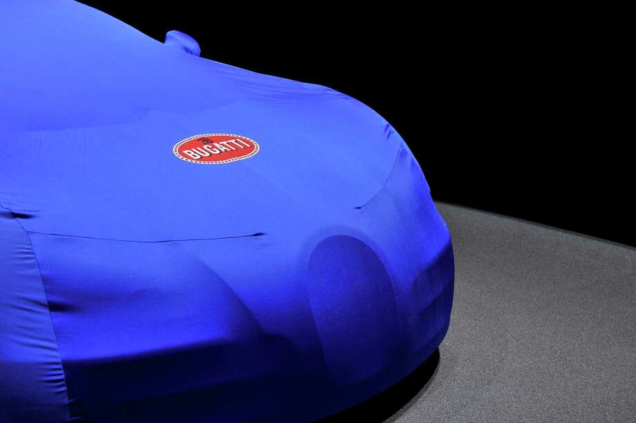 A Bugatti is prepared ahead of the opening day of the 84th International Motor Show which will showcase novelties of the car industry on March 3, 2014 in Geneva, Switzerland. Photo: Harold Cunningham, Getty Images / 2014 Getty Images