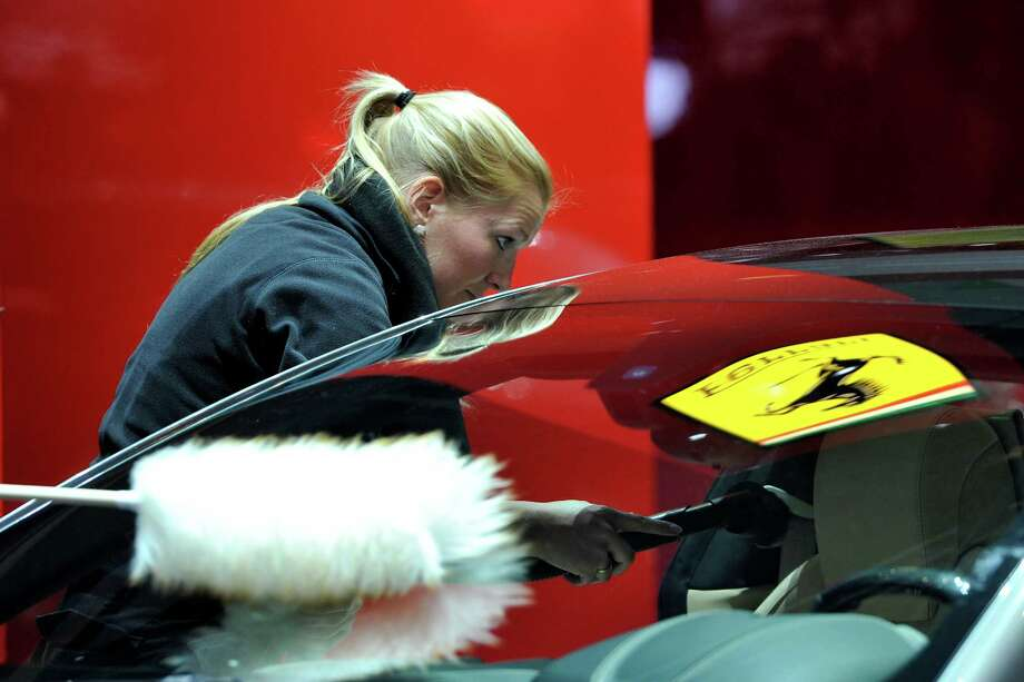 A Ferrari is prepared ahead of the opening day of the 84th International Motor Show which will showcase novelties of the car industry on March 3, 2014 in Geneva, Switzerland. Photo: Harold Cunningham, Getty Images / 2014 Getty Images