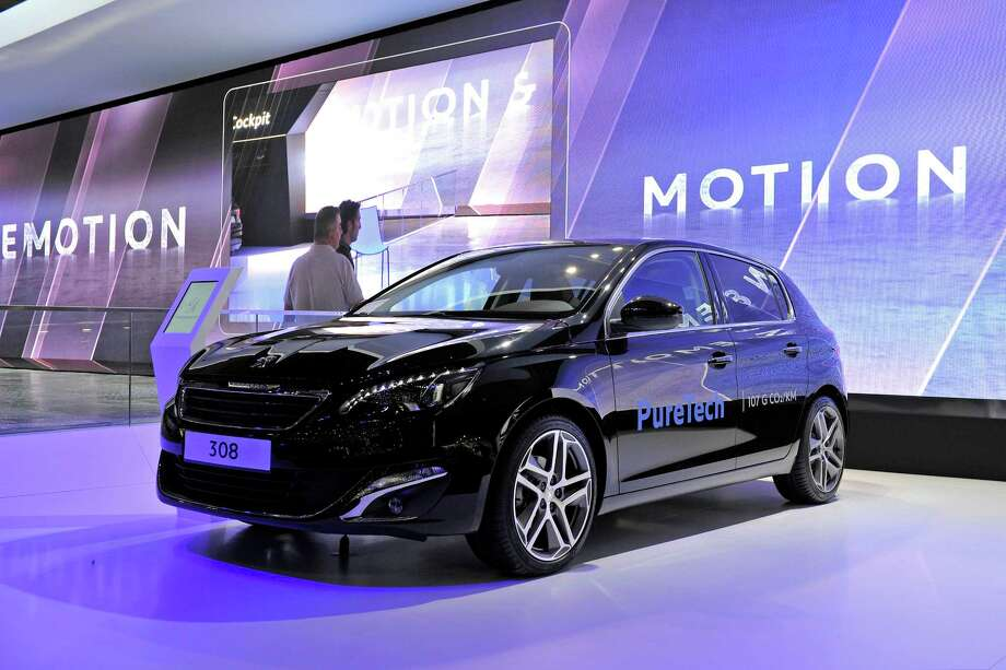 "The Peugeot 308 is awarded ""Car of the Year 2014"" during the opening day of the 84th International Motor Show which will showcase novelties of the car industry on March 3, 2014 in Geneva, Switzerland. Photo: Harold Cunningham, Getty Images / 2014 Getty Images"