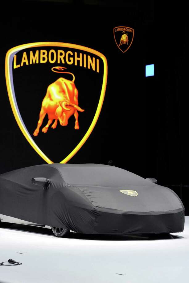 A Lamborghini is prepared ahead of the opening day of the 84th International Motor Show which will showcase novelties of the car industry on March 3, 2014 in Geneva, Switzerland. Photo: Harold Cunningham, Getty Images / 2014 Getty Images
