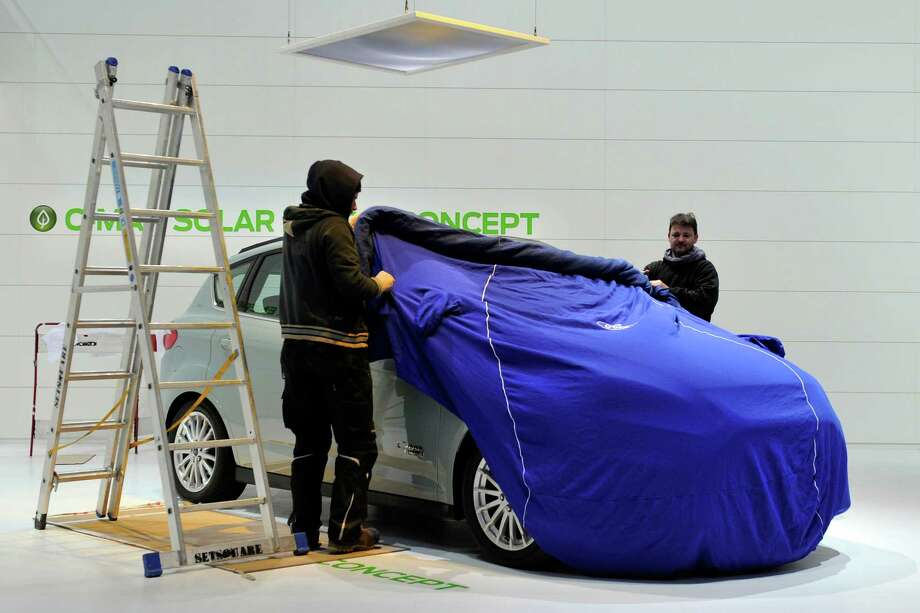 A Ford is prepared ahead of the opening day of the 84th International Motor Show which will showcase novelties of the car industry on March 3, 2014 in Geneva, Switzerland. Photo: Harold Cunningham, Getty Images / 2014 Getty Images