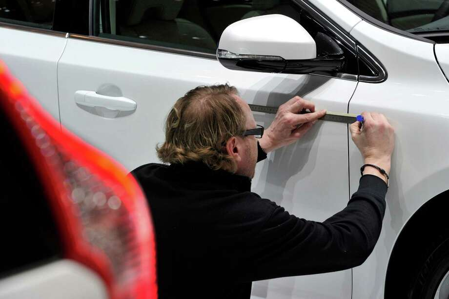 A Volvo is prepared ahead of the opening day of the 84th International Motor Show which will showcase novelties of the car industry on March 3, 2014 in Geneva, Switzerland. Photo: Harold Cunningham, Getty Images / 2014 Getty Images