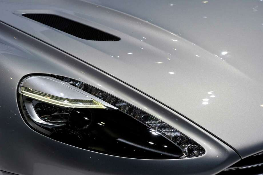 An Aston Martin is prepared ahead of the opening day of the 84th International Motor Show which will showcase novelties of the car industry on March 3, 2014 in Geneva, Switzerland. Photo: Harold Cunningham, Getty Images / 2014 Getty Images