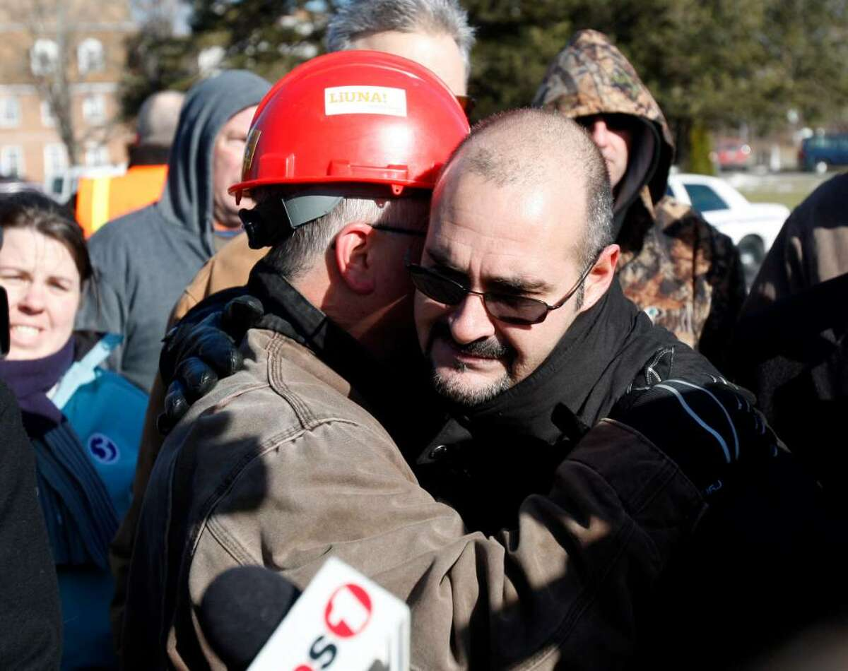 Michael Rosario, business representative for the Plumbers, Pipefitters, & HVAC Local 777, hugs a friend after telling reporters about losing three friends in the explosion at the Kleen Energy Systems power plant on Sunday in Middletown, Conn., Monday, Feb. 8, 2010. (AP Photo/Seth Wenig)
