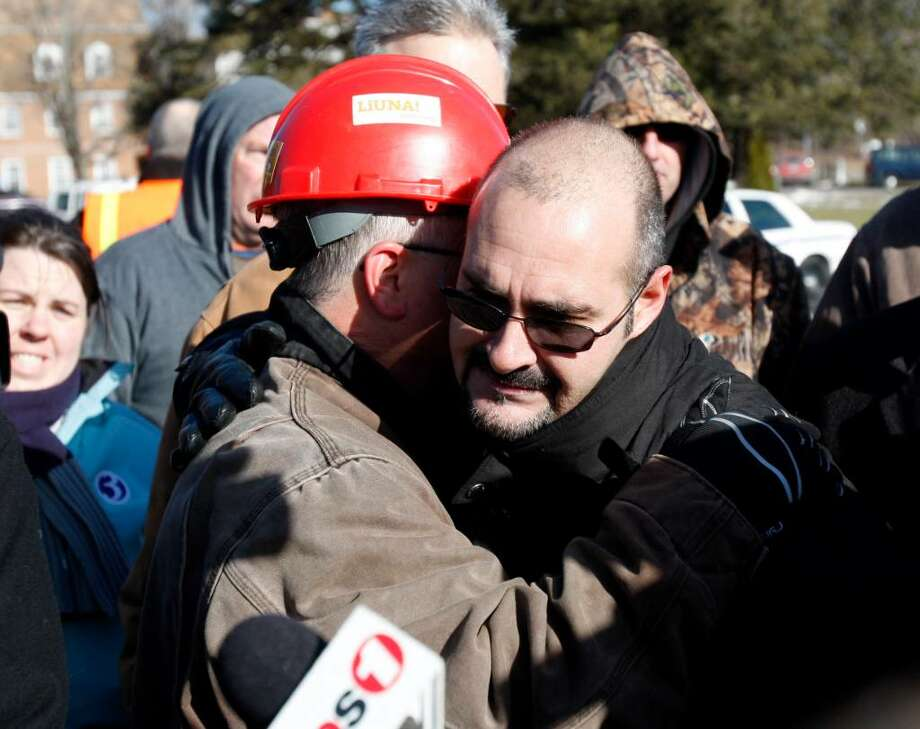 Michael Rosario, business representative for the Plumbers, Pipefitters, & HVAC Local 777, hugs a friend after telling reporters about losing three friends in the explosion at the Kleen Energy Systems power plant on Sunday in Middletown, Conn., Monday, Feb. 8, 2010.  (AP Photo/Seth Wenig) Photo: Seth Wenig, AP / AP