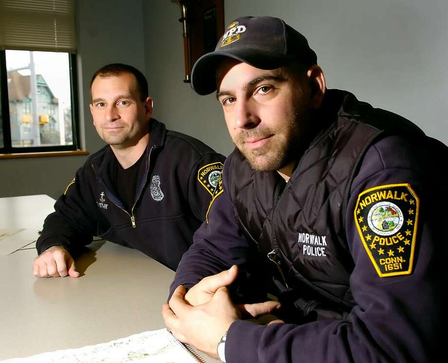 Norwalk police officers, David Vetare, left and  John Taranto, posed at Norwalk Police Headquarters Friday, Feb 5th, 2010.  The two have been selected as Norwalk Police Officers of the Year for 2009 for the heroism they displayed during a daring maritime night rescue of a suicidal boater near Tavern Island off of Norwalk in early October of 2009.  The rescue required officer Vetare to jump from the police boat to another boat moving at 30 miles per hour to rescue a passed-out suicdal man while officer Taranto pilotied the police boat. Photo: Bob Luckey / Stamford Advocate