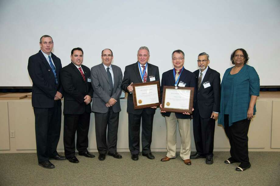 Zbigniew Czajkiewicz, dean of the University of Houston-Clear Lake's School of Science and Computer Engineering, and Andrew Yang, associate professor of Computer Science and Computer Information Systems, receive NASA's Silver Achievement Award. Photo: Courtesy Of NASA Johnson Space Center