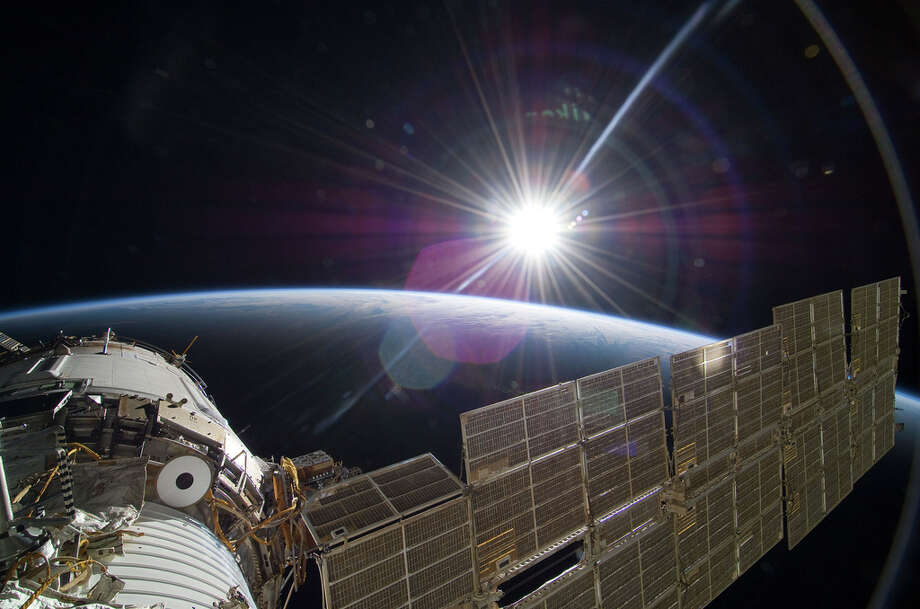 NASA describes this scene as: The bright sun greets the International Space Station in this Nov. 22 scene from the Russian section of the orbital outpost, photographed by one of the STS-129 crew members.