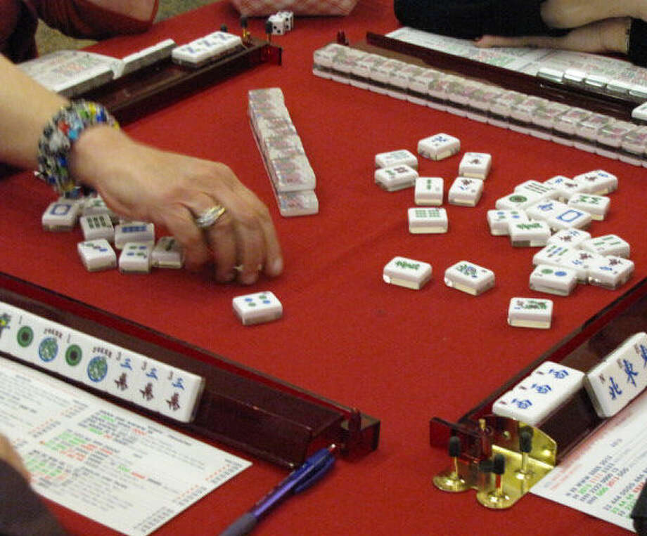 Alice Perloff's hand is a blur of motion as she swiftly moves mah jongg tiles into place during the Feb. 16 tournament.