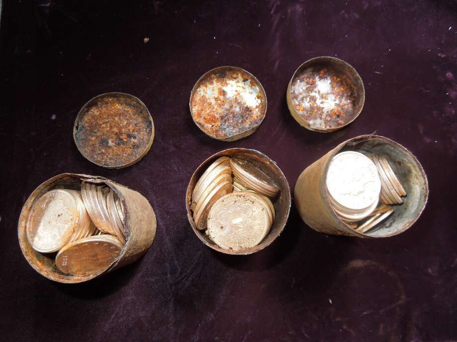 Photos show cans found in the ground and how they were filled with coins. A sampling of the fortune of 19th century gold coins found in the Gold Country of California. Photo: Kagin's