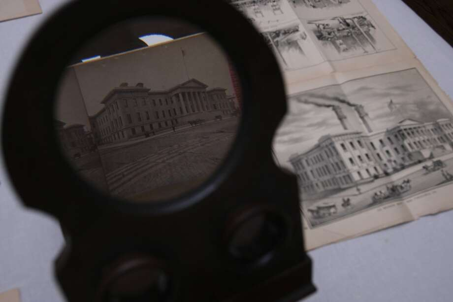 "A view of the old San Francisco Mint is seen through a stereoscopic viewer next to a copy of ""Wasp"", a mid-19th Century satirical magazine on Friday, Feb. 28, 2014 in Lafayette, Calif. Robert Chandler, a foremost historian of the Old West believes that the recently found stash of gold coins worth $10 million is likely to be the accumulation of someone's life savings. Photo: The Chronicle"