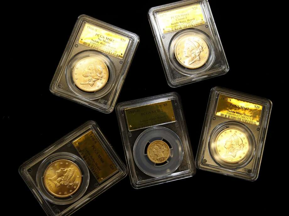 Kagin's specialists had the coins carefully cleaned and placed in acrylic cases for safe keeping Thursday February 20, 2014 in Tiburon, Calif. A fortune in 19th century gold coins found in the Gold Country of California will soon be for sale on Amazon and to serious collectors by the numismatics experts at Kagin's. Photo: The Chronicle