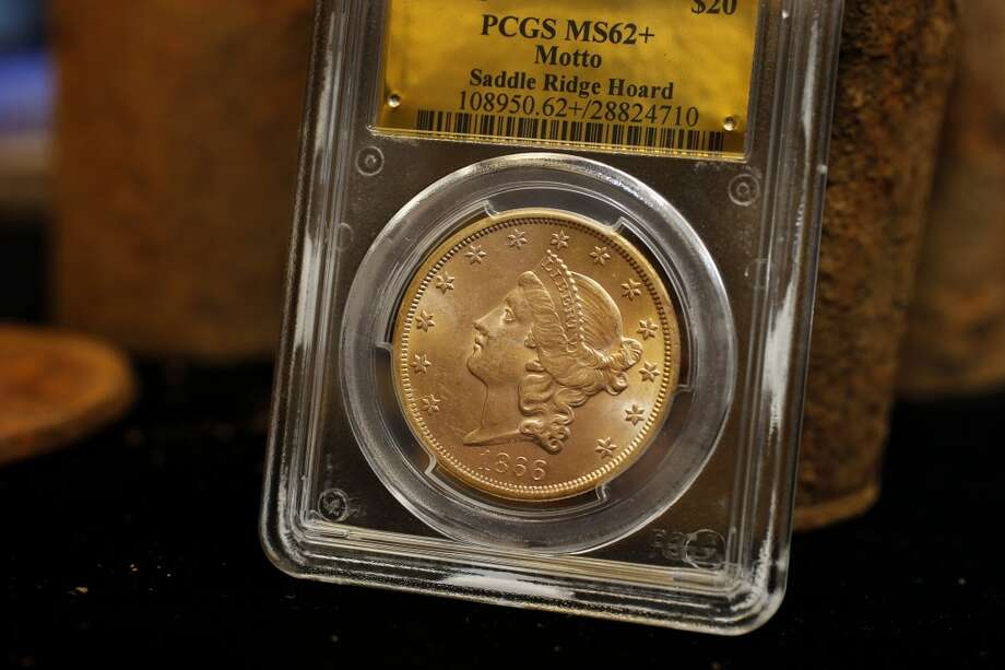 A $20 gold piece minted in San Francisco in 1866, part of the found fortune, Thursday February 20, 2014 in Tiburon, Calif. A fortune in 19th century gold coins found in the Gold Country of California will soon be for sale on Amazon and to serious collectors by the numismatics experts at Kagin's. Photo: The Chronicle