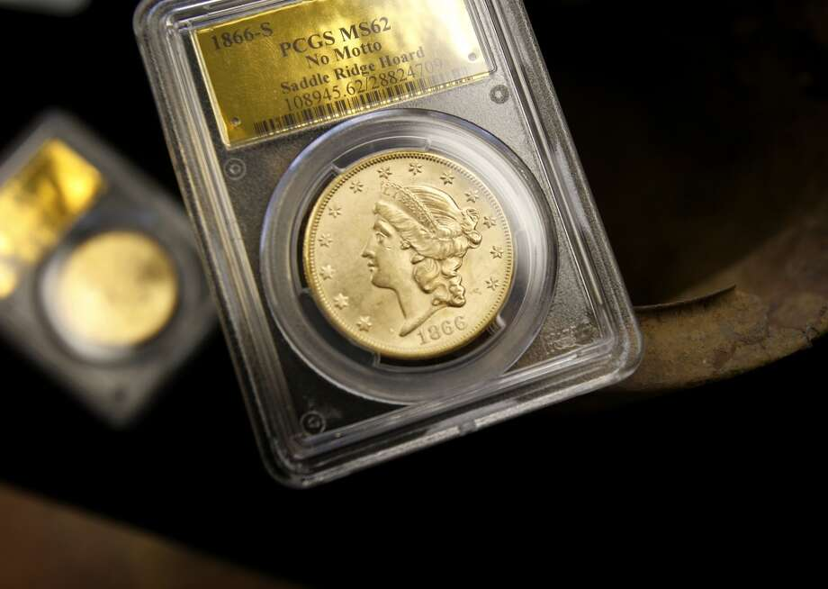 An 1866 gold piece photographed next to the can where it was found Thursday February 20, 2014 in Tiburon, Calif. A fortune in 19th century gold coins found in the Gold Country of California will soon be for sale on Amazon and to serious collectors by the numismatics experts at Kagin's. Photo: The Chronicle