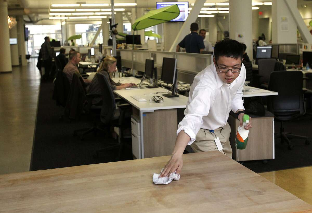 Eric Lin, 26, wipes down a communal table near one of the kitchens Feb. 26, 2014 at Zendesk in downtown San Francisco, Calif. With help from The Arc San Francisco, Lin has been working in Office Services Support since April, 2012. Lin, who works 4 hours a day, five days a week, is in charge of keeping the kitchens and conference rooms stocked and clean. Over the years, he has added hours and new tasks, which he keeps track of using a list with check marks he refers to periodically throughout the day. Lin is able to remember the names of most of the employees he interacts with on a daily basis and even has nicknames for many. He hopes to be re-hired as a Ghiradelli Chocolateer at AT&T Park this spring.
