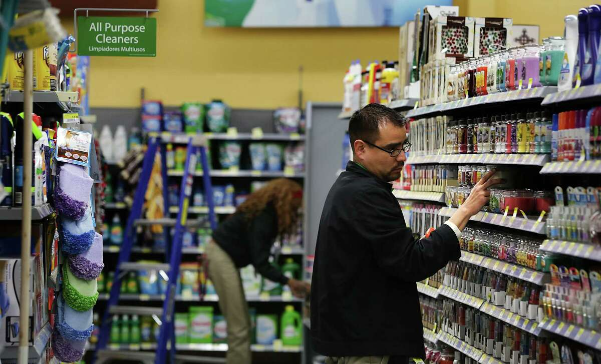 Robert Barba, Merchandise Supervisor at the new Walmart Market, adjusts items on a shelf. Walmart will be opening it's first Neighborhood Market store in San Antonio at the corners of Ellison Dr. and Marbach Rd., which will focus on grocery, pharmacy and some general merchandise items. Thursday, Feb. 27, 2014.