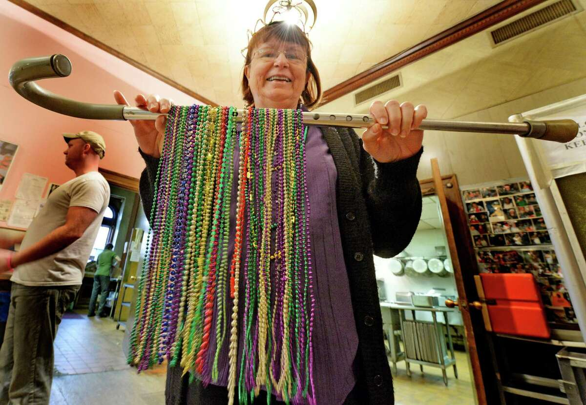 Staff member Janet Chiefari holds a cane full of beads during the Mardi Gras celebration March 4, 2014 at the Senior Citizens Center in Troy, N.Y. (Skip Dickstein / Times Union)