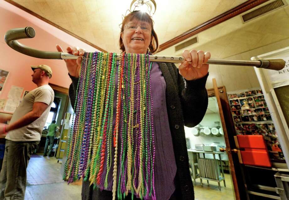 Staff member Janet Chiefari holds a cane full of beads during the Mardi Gras celebration March 4, 2014 at the Senior Citizens Center in Troy, N.Y.          (Skip Dickstein / Times Union) Photo: SKIP DICKSTEIN / 00025951A