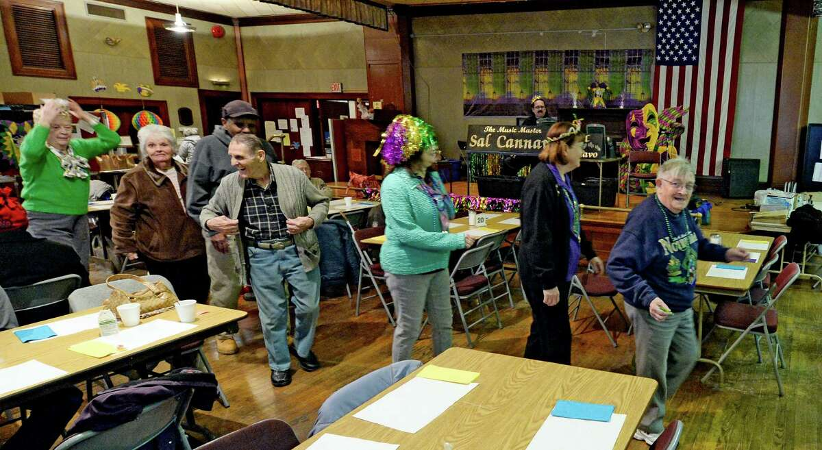 The seniors are up and parading around the room during the Mardi Gras celebration March 4, 2014 at the Senior Citizens Center in Troy, N.Y. (Skip Dickstein / Times Union)