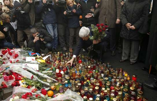 """Secretary of State John Kerry places roses atop the Shrine of the Fallen in Kiev, Ukraine March 4, 2014. The Shrine of the Fallen, located on Institutska Street, honors the fallen Heroes of the """"Heavenly Sotnya"""" (Hundred). Over the course of the EuroMaidan protests, almost 100 protesters were killed by police.  (AP PHoto/Kevin Lamarque, Pool) Photo: Kevin Lamarque, Associated Press"""