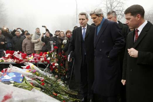 """Secretary of State John Kerry visits the Shrine of the Fallen in Kiev, Ukraine, Tuesday, March 4, 2014. The Shrine of the Fallen, located on Institutska Street, honors the fallen Heroes of the """"Heavenly Sotnya"""" (Hundred). Over the course of the EuroMaidan protests, almost 100 protesters were killed by police. AP Photo/Kevin Lamarque, Pool) Photo: Kevin Lamarque, Associated Press"""