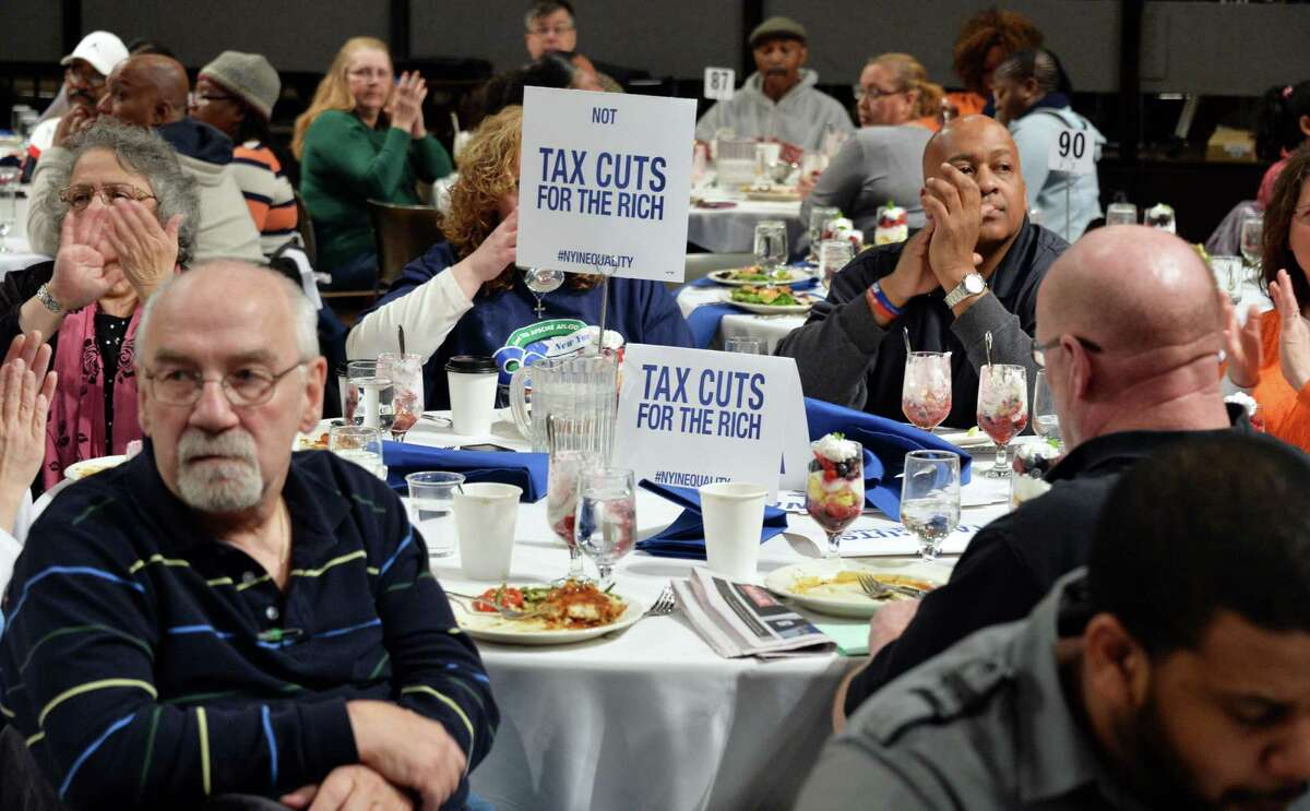 First responders, law enforcement personnel, nurses, teaching assistants and other public service employees attend New York AFSCME's annual Albany Lobby Day lunch Tuesday, March 4, 2014, at the Empire State Convention in Albany, N.Y. (John Carl D'Annibale / Times Union)