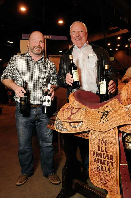 Award winners John Rivenburgh from Bending Branch and Michael Phillips from Michael David Winery hold each other's wines at the Rodeo Uncorked! Roundup and Best Bites Competition at the Reliant Center. Photo: Dave Rossman, Freelance / Freelance