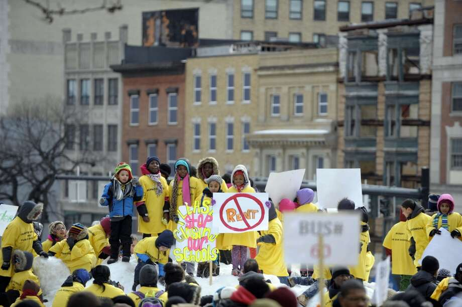 Parents, students, teachers and supporters from charter schools from around the state take part in a rally outside the capitol on Tuesday, March 4, 2014 in Albany, NY. (Paul Buckowski / Times Union) Photo: Paul Buckowski, Albany Times Union