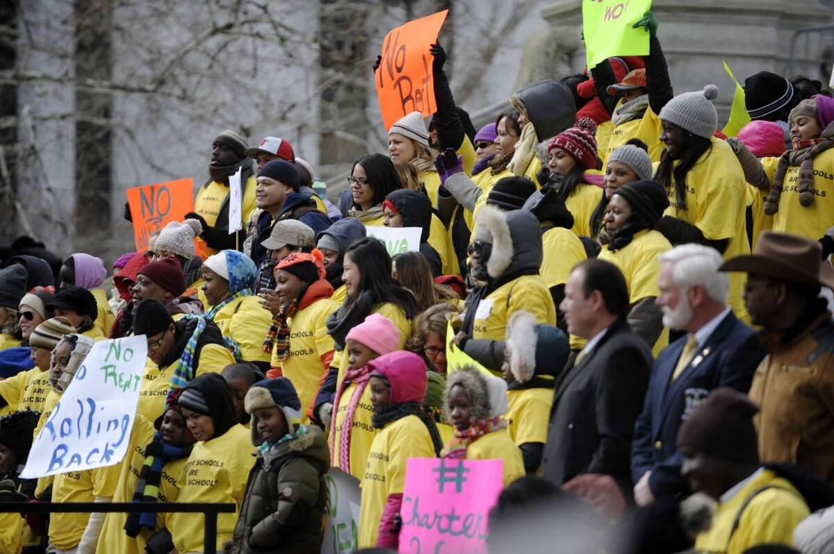 Parents, students, teachers and supporters from charter schools from around the state take part in a rally outside the capitol on Tuesday, March 4, 2014 in Albany, NY. (Paul Buckowski / Times Union)