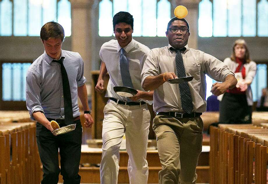 For heaven's cakes:Unlike the Olney event, the Washington National Cathedral's Pancake Race apparently permits young male executives. Because of inclement weather, the race was held in the nave of the cathedral. Photo: Win McNamee, Getty Images