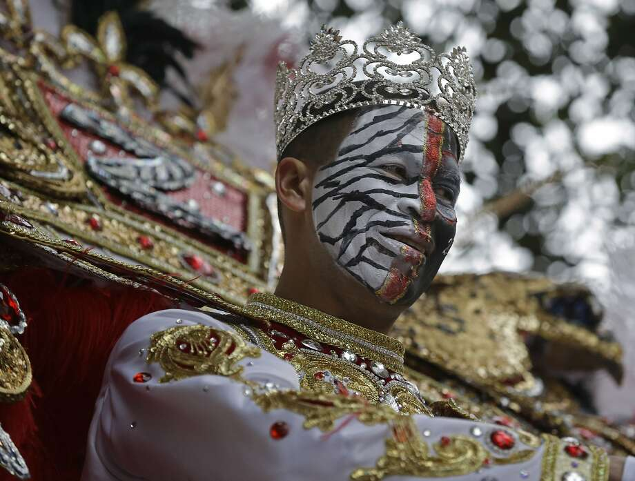 Garren Thomas Mims Sr., King of the Krewe of Zulu, rides his float during Mardi Gras in New Orleans, Tuesday, March 4, 2014.  Photo: Gerald Herbert, Associated Press