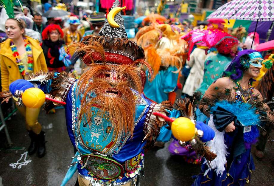 Members of the Krew of Mondo Kayo Social Marching Club parde Mardi Gras day in the rain on March 4, 2014 in New Orleans, Louisiana Photo: Sean Gardner, Getty Images