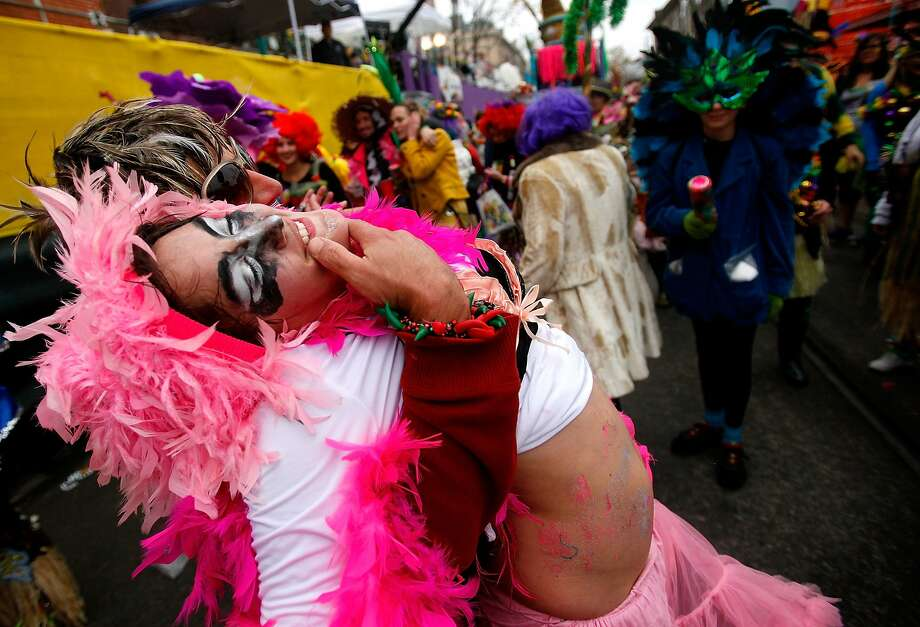 Members of the Krew of Mondo Kayo Social Marching Club parde Mardi Gras day in the rain on March 4, 2014 in New Orleans, Louisiana. Fat Tuesday, the traditional celebration on the day before Ash Wednesday and the begining of Lent, is marked in New Orleans with parades and marches through many neighborhoods in the city. Photo: Sean Gardner, Getty Images