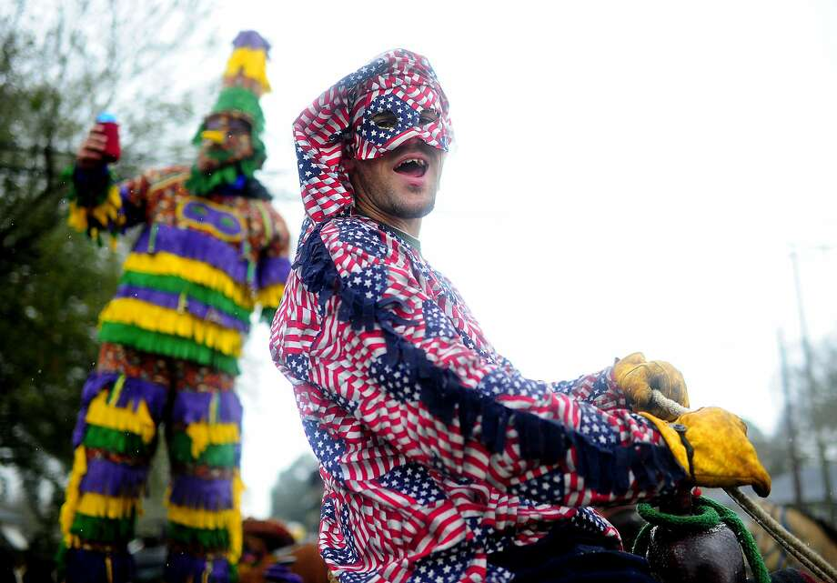 Jacob Perron shouts as he and fellow costumed riders prepare for the Courir de Mardi Gras à Grand Mamou in Mamou, La., Tuesday, March 4, 2014. Participants continue the Cajun tradition of chasing chickens and traveling to local homes to gather ingredients for a community gumbo. Photo: Paul Kieu, Associated Press