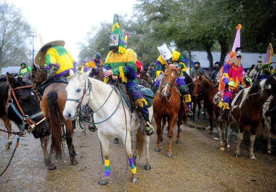 Costumed riders prepare to participate in the Courir de Mardi Gras à Grand Mamou in downtown Mamou, La., Tuesday, March 4, 2014. Participants continue the Cajun tradition of chasing chickens and traveling to local homes to gather ingredients for a community gumbo.  Photo: Paul Kieu, Associated Press