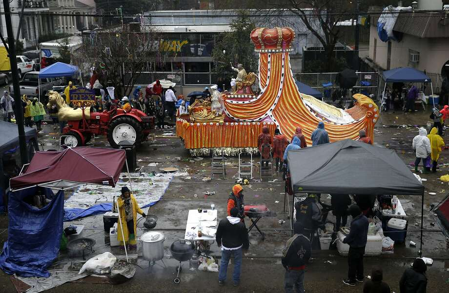 King of the Krewe of Rex, Jack Laborde, rides on his float down a largely empty St. Charles Ave., during Mardi Gras day in New Orleans, Tuesday, March 4, 2014. Rain and unusually cold temperatures kept the normally massive and festive crowds away. Photo: Gerald Herbert, Associated Press